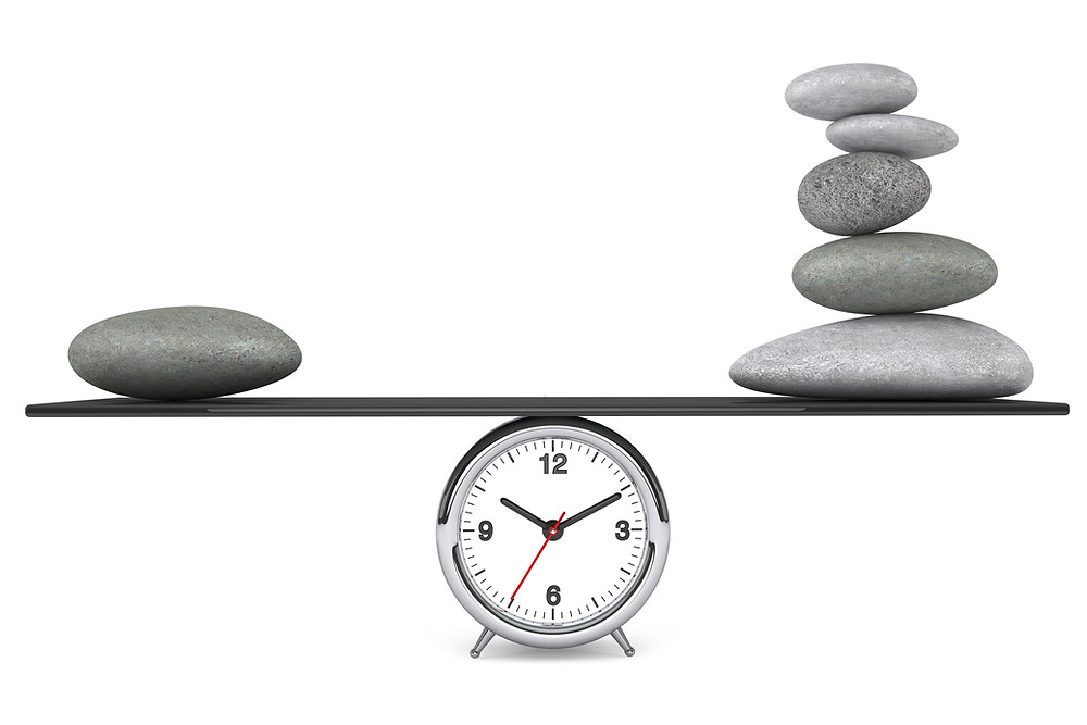 rocks balancing over a clock - live a balanced life by choosing GREAT over just good