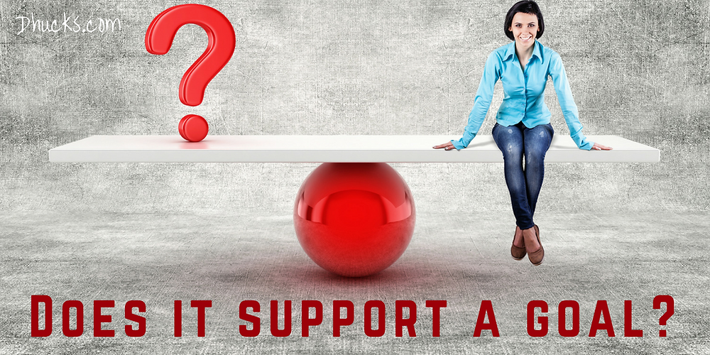"woman and question balancing. ""does it support a goal?"""