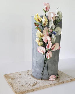 Gray barrel with flowers