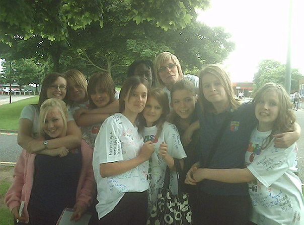 Group of school children hugging on the last day