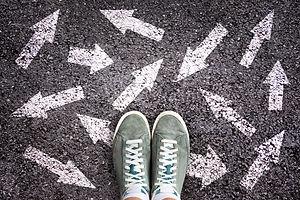 Teen in sneakers unsure of direction