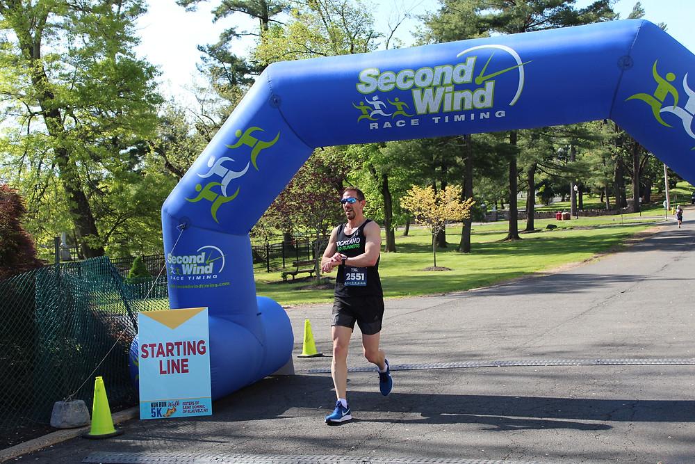 Gary Holland finishing first at the 2019 Nun Run/Walk 5K