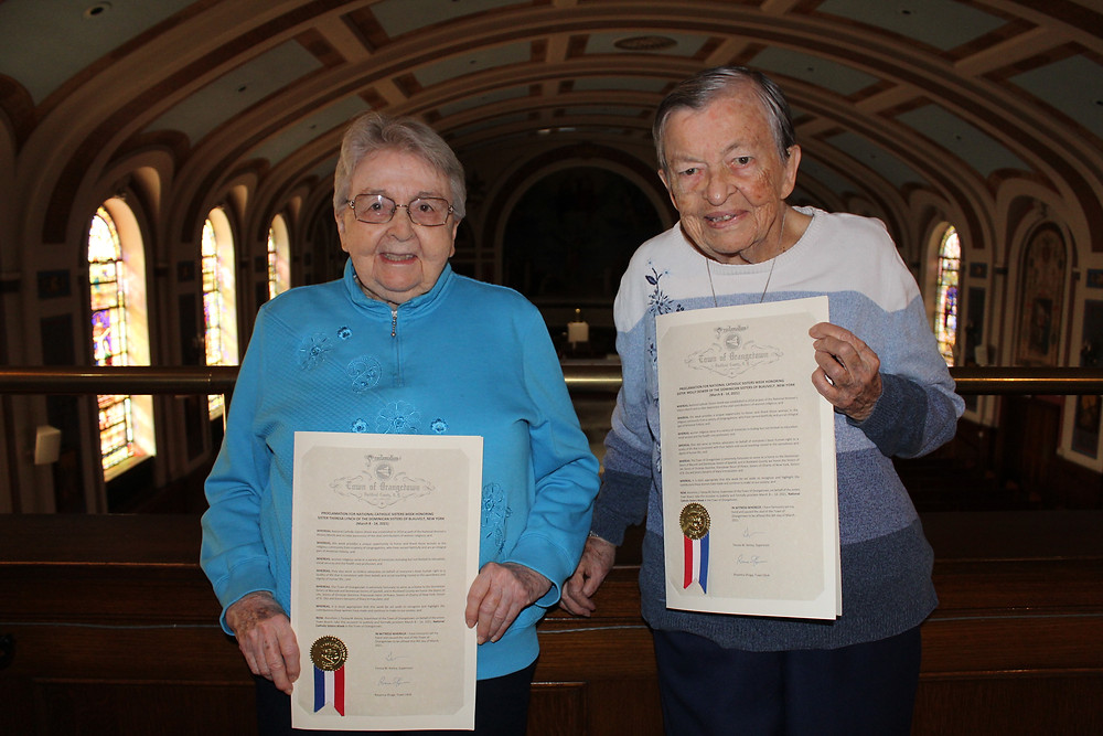 Sisters Theresa Lynch and Molly Dower with their Proclamations.
