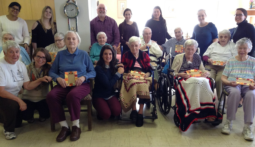 Sisters and Dominican College students and faculty gather together at the Motherhouse