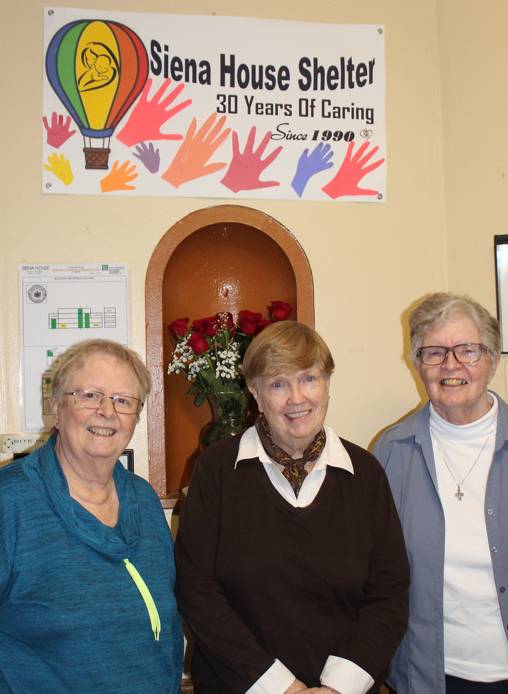 Sisters Cely Byrnes, Joan Marie McKinney, and Mary Doris at Siena House.