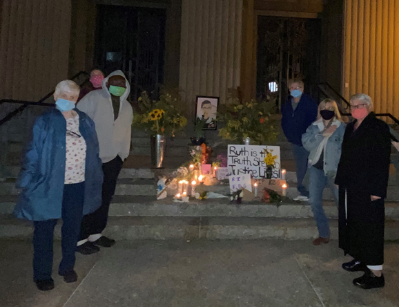 Sisters Noreen Walsh and Dorothy Maxwell join others to mourn the passing of Supreme Court Justice, Ruth Bader Ginsburg.
