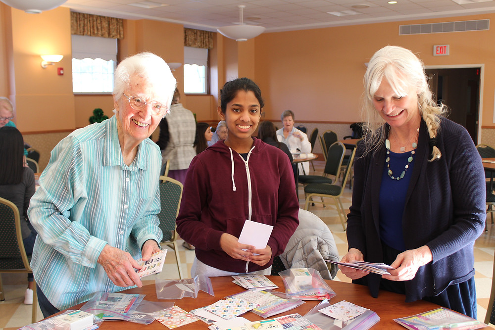 Sister Pat Horan, a Tappan Zee High School student and Ms. Parker-Hennion participate in Ministry Service Day