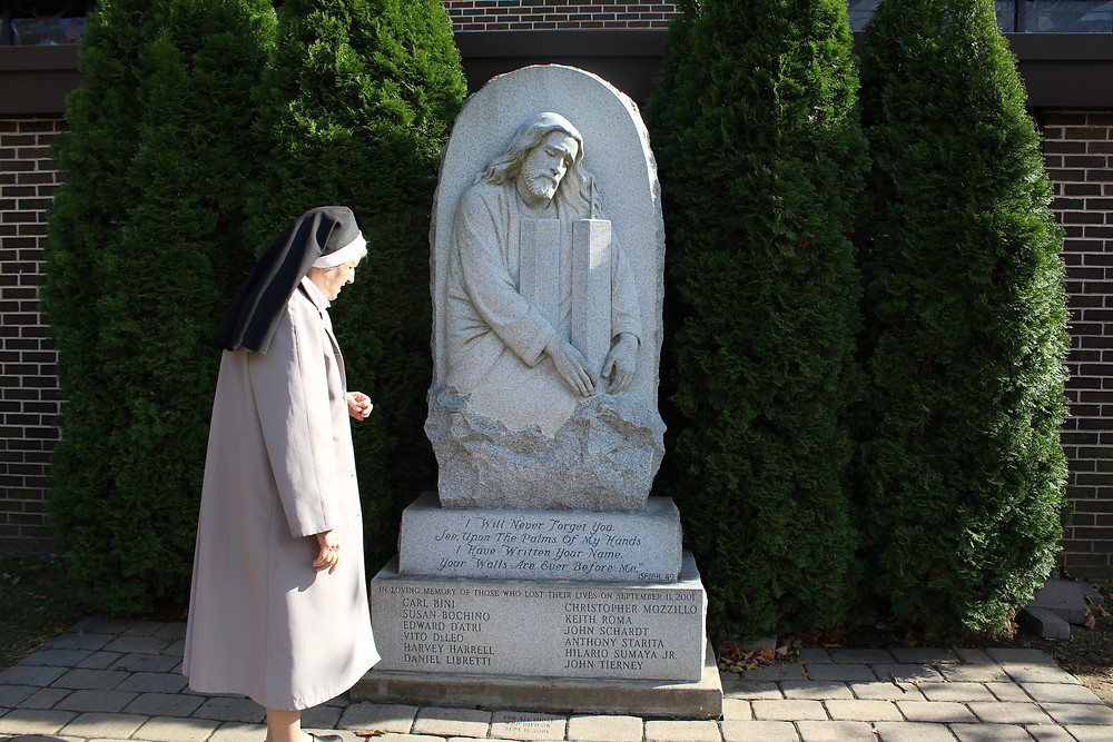 Sr. Jeanine Conlon, OP, stands outside of St. Charles Church