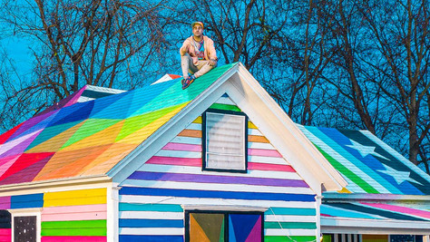 OKUDA san miguel transforms neglected home into 'rainbow embassy' art center