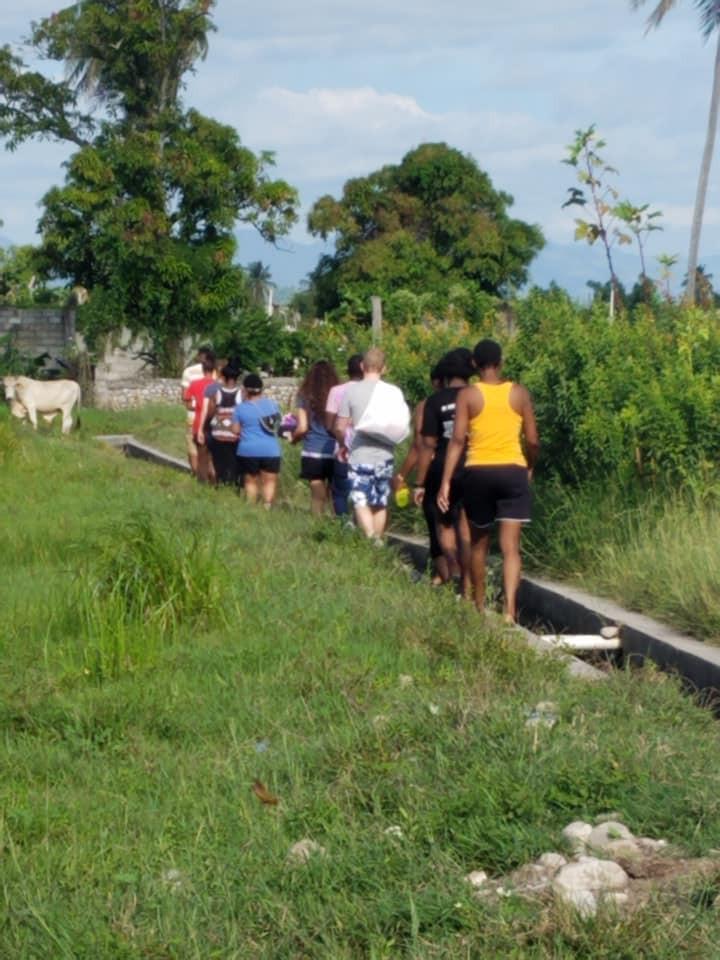 HSC volunteers walking through rice fields