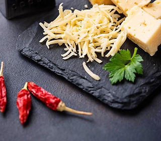 grated-cheese-on-slate-board-2DF6XS4.jpg