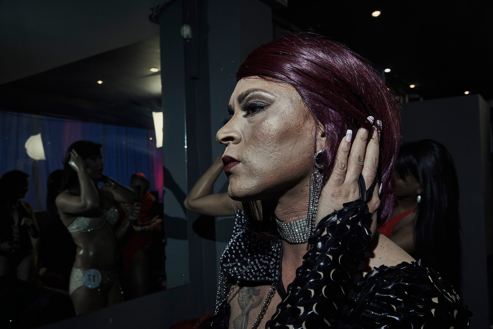 Chante Herries, a pageant queen and hair dresser, is getting ready backstage for the swimwear category of the LGBT Cape Peninsula pageant. The event is aimed at creating a positive understanding about the different forms of expression and identification of the LGBTQ family.
