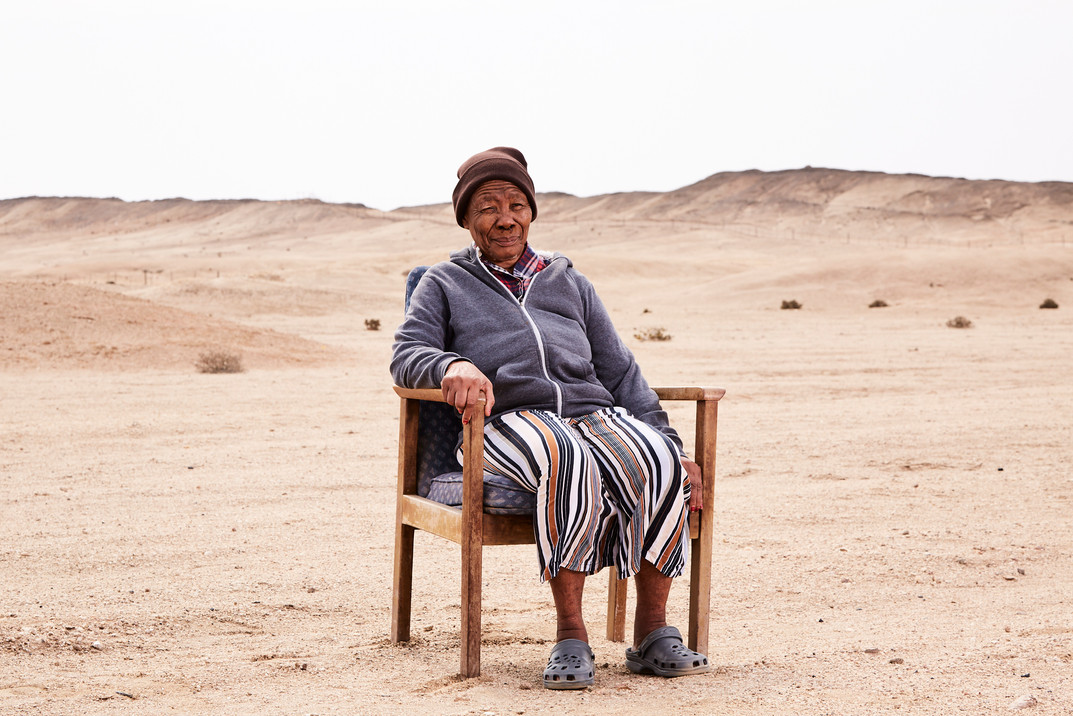 Ndjiinaa Ngombe (81), a Himba woman, and sister to Hikuminue Kapika (previous image), at the ADN Care Farm outside Swakopmund. After 20 years in chains, Ngombe was released with the help of Alzheimer's Dementia Namibia (ADN) and first cared for outside her village in Epupa for 18 months. Ngombe was never fully reintegrated into the Himba community because of the fear and stigma surrounding the disease and was moved to the ADN Care Farm for her own wellbeing. 24 October 2020.