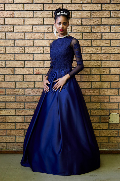 Bilaees Gamiet (17) from Salt River attended Salt River High's matric dance with her date Kivan Abbas. She is one of 10 siblings and the first to graduate from high school on her father's side. Her proud family hosted a get together before the dance at a community hall in Salt River.
