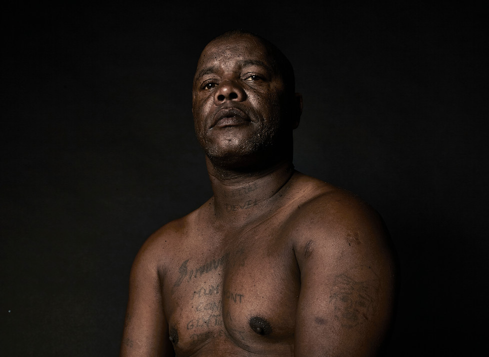 On the 16th of June 2014 I was shot in the head and the bullet came out the roof of my mouth. It's a miracle that I'm still alive. I should have been paralysed. My own friends shot me through the head. Gang life is like that. Even your own brothers turn against you. I knew I had to change my life. I got the nickname Little Devel (Devil) when I was in prison at Victor Verster and so I got it tattooed on my neck. This caused some problems for me when I changed my life and I got a job at the NG church. When the pastor saw my tattoo he asked me not to come back to work the next day. Changing your life is very difficult, because people in the community still judge you. It takes a long time for them to believe that a once violent person has changed. But change is possible and you just have to school yourself in this new way of life. Samuel Gerwel