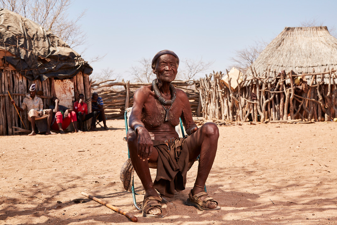 Hikuminue Kapika (83), chief of the Himba tribe in his village in the Omuramba area in Epupa Namibia. Kapika's sister, Ndjiinaa Ngombe, a person living with dementia, was 'diagnosed' as a witch by a witch doctor and chained in a hut in this village for 20 years. 18 October 2020