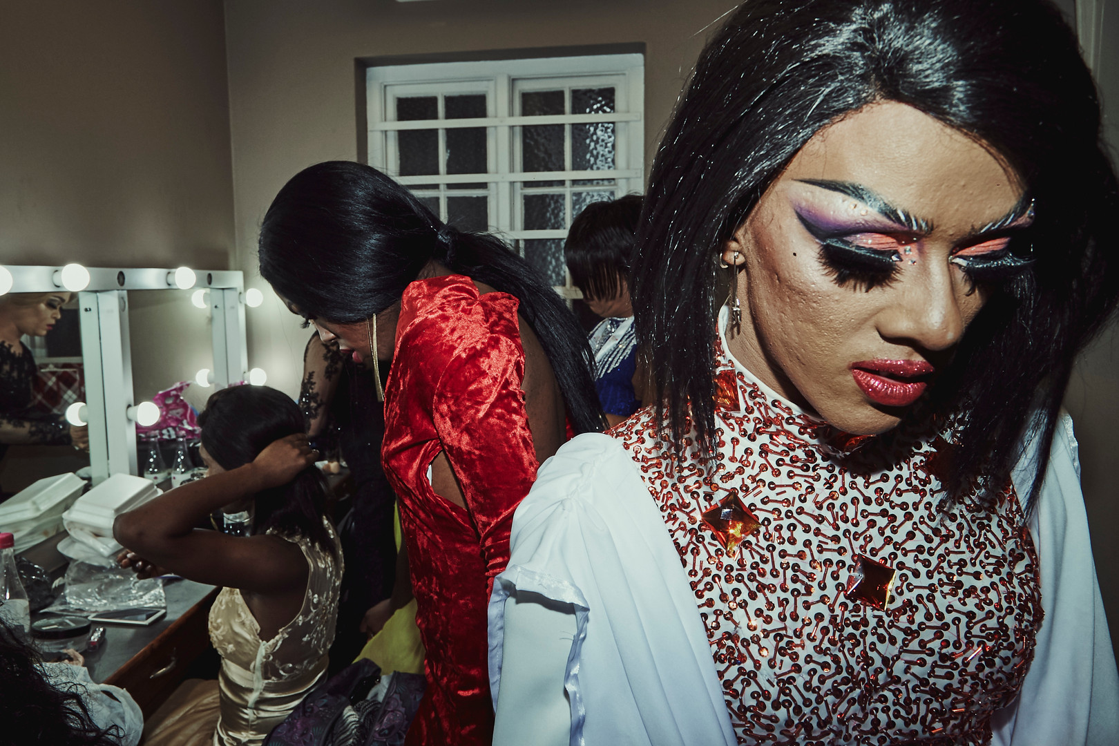 Ina Propriette exits her dressing room at the Port Elizabeth Opera House where the Miss Drag South Africa Pageant was held in September 2018. She was one of two Cape Town drag artists who competed for the title and she was crowned first runner up during the crowning gala.