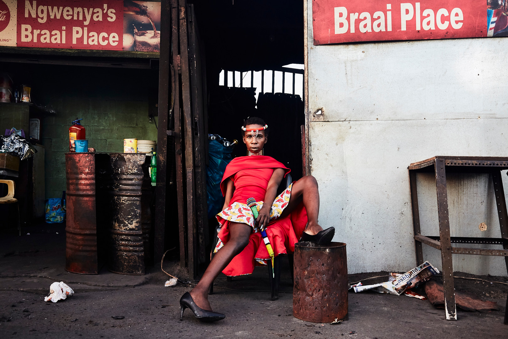 "Mandisi Dolle Phika, from Paarl, poses in a section of the tshisanyama in Khayelitsha. ""I have faced homophobia since Primary School. The word 'mofffie' was often used to humiliate and break me. It is this derogatory term which was used as a weapon to shut me out. I started referring to myself as a 'moffie' so that the word would not hurt me. I used the word to empower myself. Whenever I was referred to as a 'moffie', I would not be hurt. The word lost its power to dismantle and demean me."" Aug. 4, 2019."