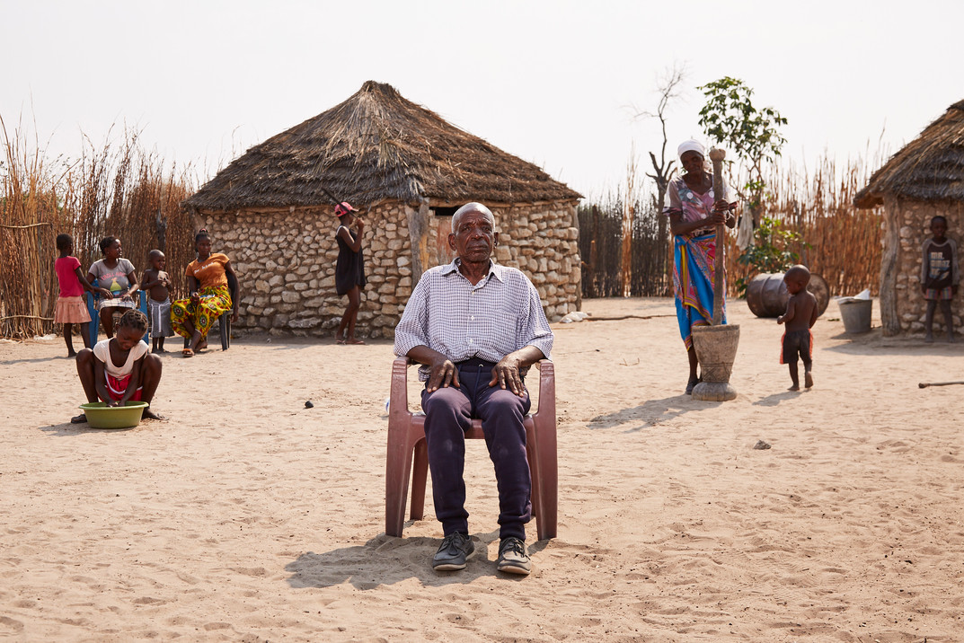 Titus Ihemba (73), a person living with dementia from the Kavango tribe is pictured with his family in Sizongoro Village, Rundu. Accused of witchcraft and unable to clear his name despite being stripped of his wealth in lieu of fines by a witch doctor, Ihemba is still unable to live with his family due to threats from the community. 6 October 2020.