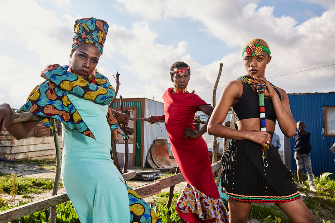 "Belinda Qaqamba Kafassie (left), Mandisi Dolle Phika (middle) and Mthulic Vee Vuma (right) in Khayelitsha dressed in traditional female Xhosa garments in an act to frame their identity with their culture. ""We can't separate our queerness from our Xhosa heritage and therefore we use it to enforce our identity. To erase a significant part of someone's identity is to invalidate their full existence. This is problematic because it somehow gives muscle to the erroneous idea of homosexuality being perceived as 'unAfrican,'"" the group explains. Aug. 4, 2019."
