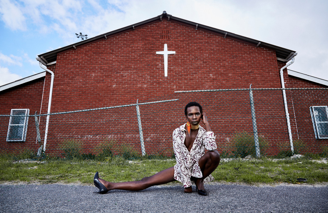 "Mandisi Dolle Phika, from Paarl, chose to create her portrait in front of a church in Khayelitsha. ""The church is often used as an institution to promote anti-queerness; so I chose the church as a way of reclaiming our sacred spaces and to give visual meaning to the God we believe loves us the way we are. I believe that a colourful God exist, one that appreciates and celebrates diversity in all its manifestations."" Aug. 4, 2019."