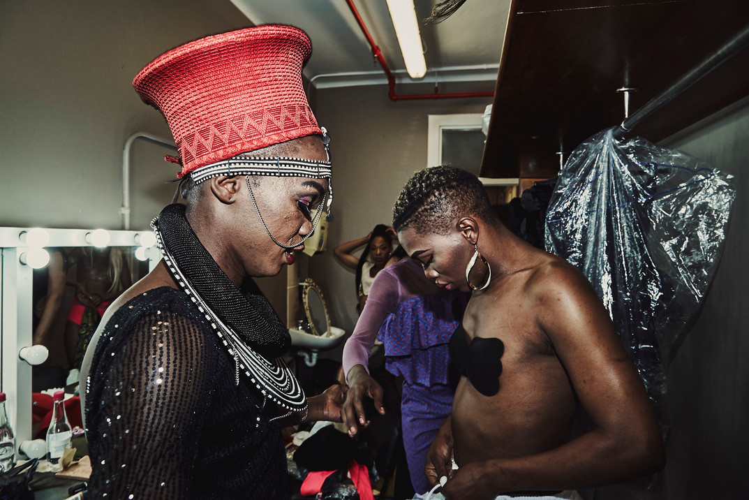 Paulina Kars (left) and Noxolo Grootboom (right) prepare for the theme wear category of the Miss Drag South Africa Pageant that was held in September 2018. The theme was cultural heritage and contestants dressed up in elaborate gowns and headpieces that related to their heritage.