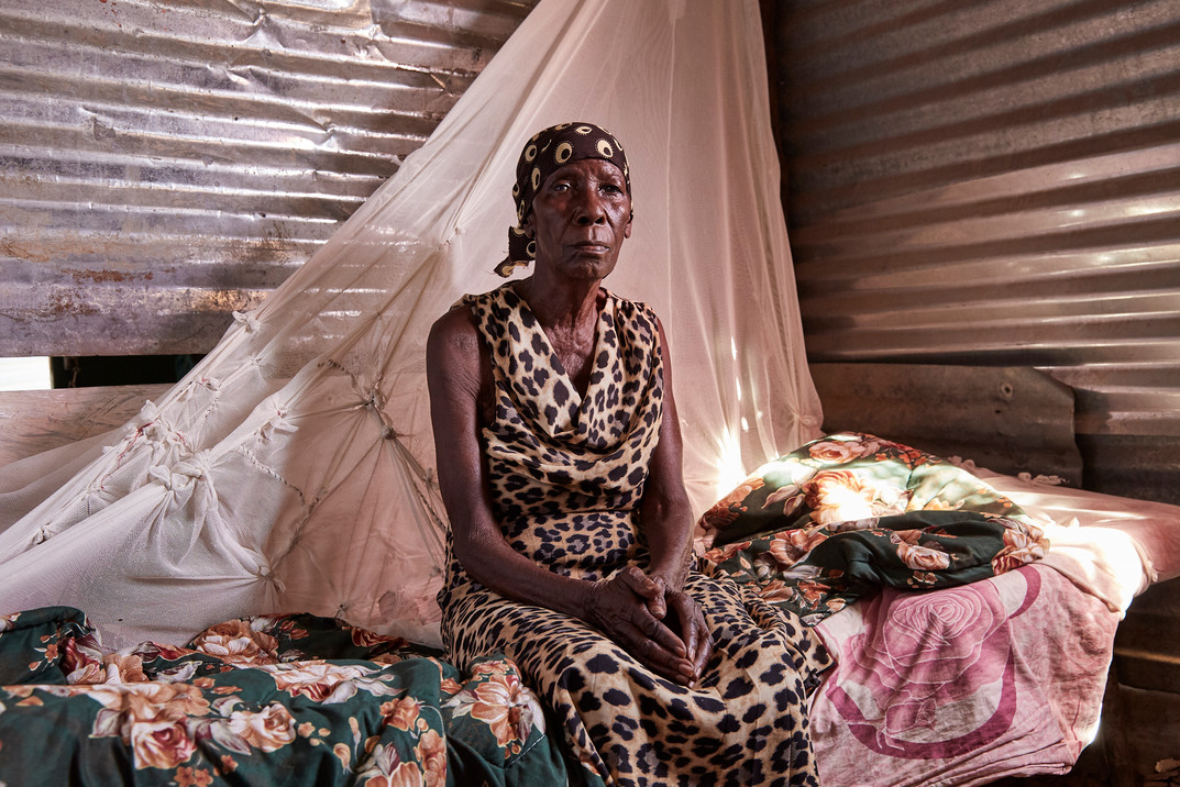 Aune Lumbala (80), a person living with dementia from the Kavango tribe at home in Sauyemwa township, Rundu. Lumbala was accused of being a witch by her son-in-law for causing the deaths of her daughter and granddaughter, who died of HIV. She was removed from her village for her own safety. 8 October 2020