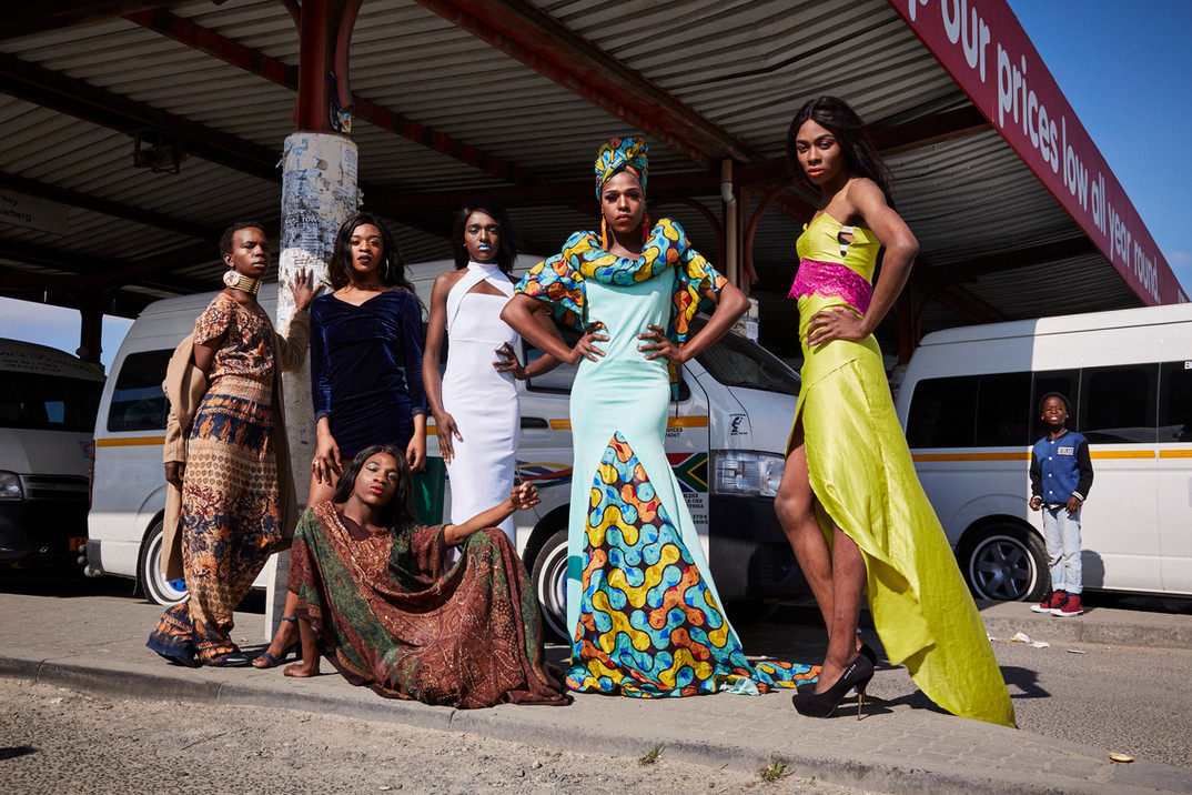 The team of #blackdragmagic pose for a group shot at the taxi rank in site C Khayelitsha. This is done as an act of activism to reclaim the township and to stand up against the overwhelming climate of discrimination members of the LGBTQI+ community face in the township. With this portrait the group intends to send a clear message that public and community spaces need to be safe spaces for members of the LGBTQI+ community. Aug. 4, 2019.