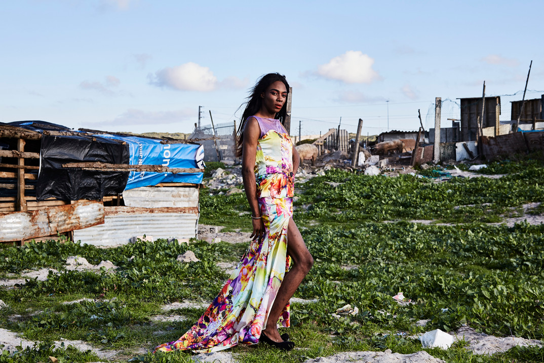 "Shakira Mabika, who identifies as a trans woman, emigrated to South Africa from Zimbabwe, where former president Robert Mugabe, ""has referred to people like me as 'pigs' and un-African."" She chose to be photographed by dilapidated shacks where pigs were kept behind a fence. ""I moved to Cape Town, South Africa in search of a space where I could live my truth,"" she says. After that move in 2013, she has faced transphobia and xenophobia. Aug. 4, 2019."
