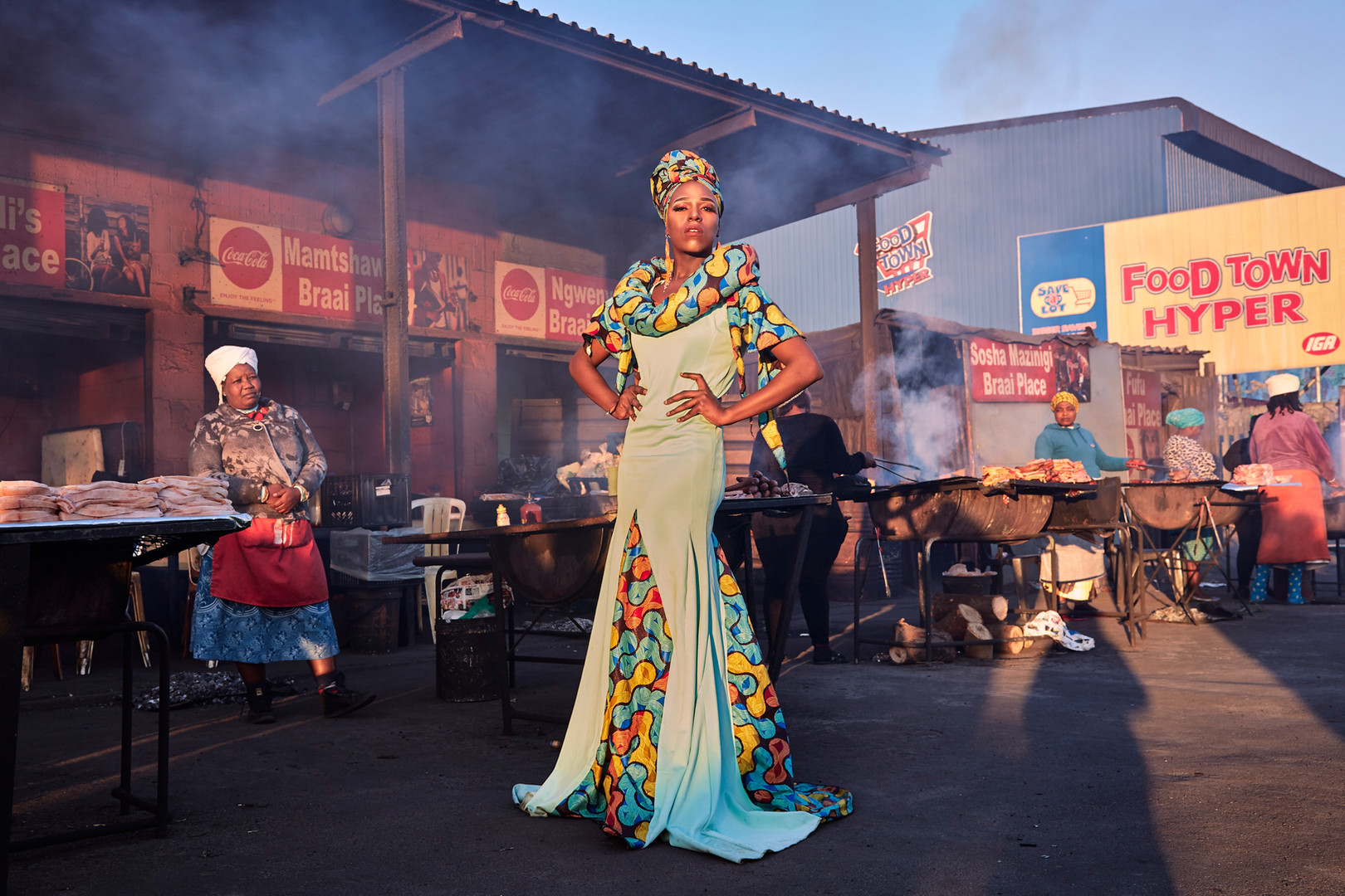 "Belinda Qaqamba Kafassie, a drag artist and activist from Elands Bay, poses at the shisanyama in Khayelitsha, a community space where women cook and sell meat. Kafassie started drag as an escape from the oppression they felt at Stellenbosch University for being ""black, Xhosa, poor, queer and effeminate."" Instead of conforming to the westernised standards of drag, Kafassie uses their unique style to elevate and celebrate African drag as an art that tells stories about Africans in Africa, the African way. Aug. 4, 2019."