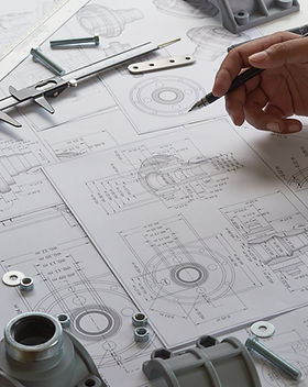 Engineer technician designing drawings m