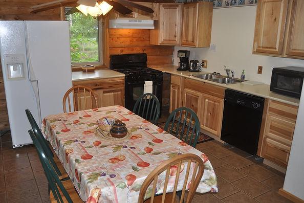 Kitchen/Dining side of front room - Daniels Lake Cabins/Kenai Peninsula, Alaska/Vacation Rentals