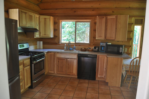 Kitchen/dining side of front room - Daniels Lake Cabins/Kenai Peninsula, Alaska/Vacation Rentals