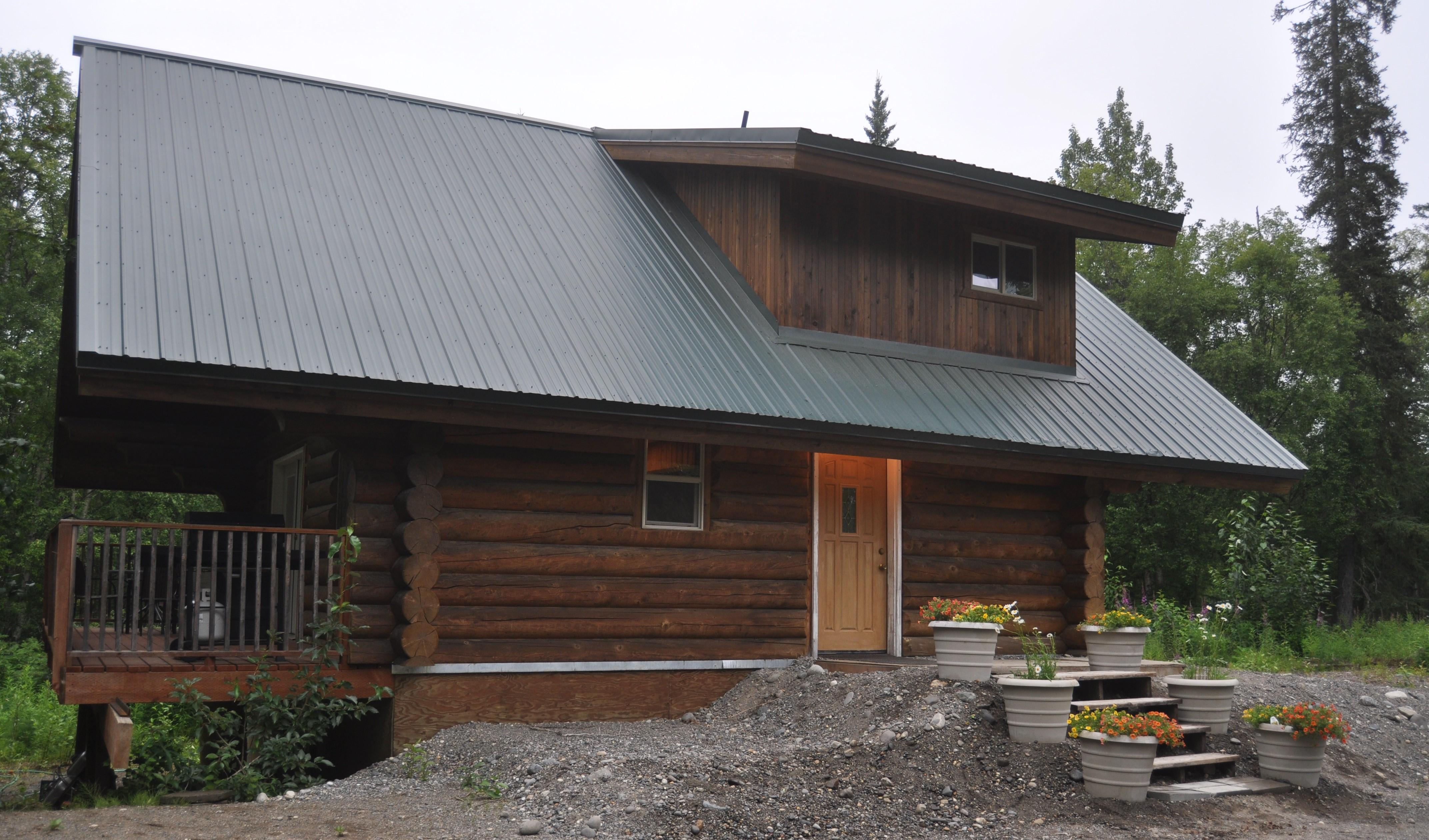Hilltop cabin driveway side
