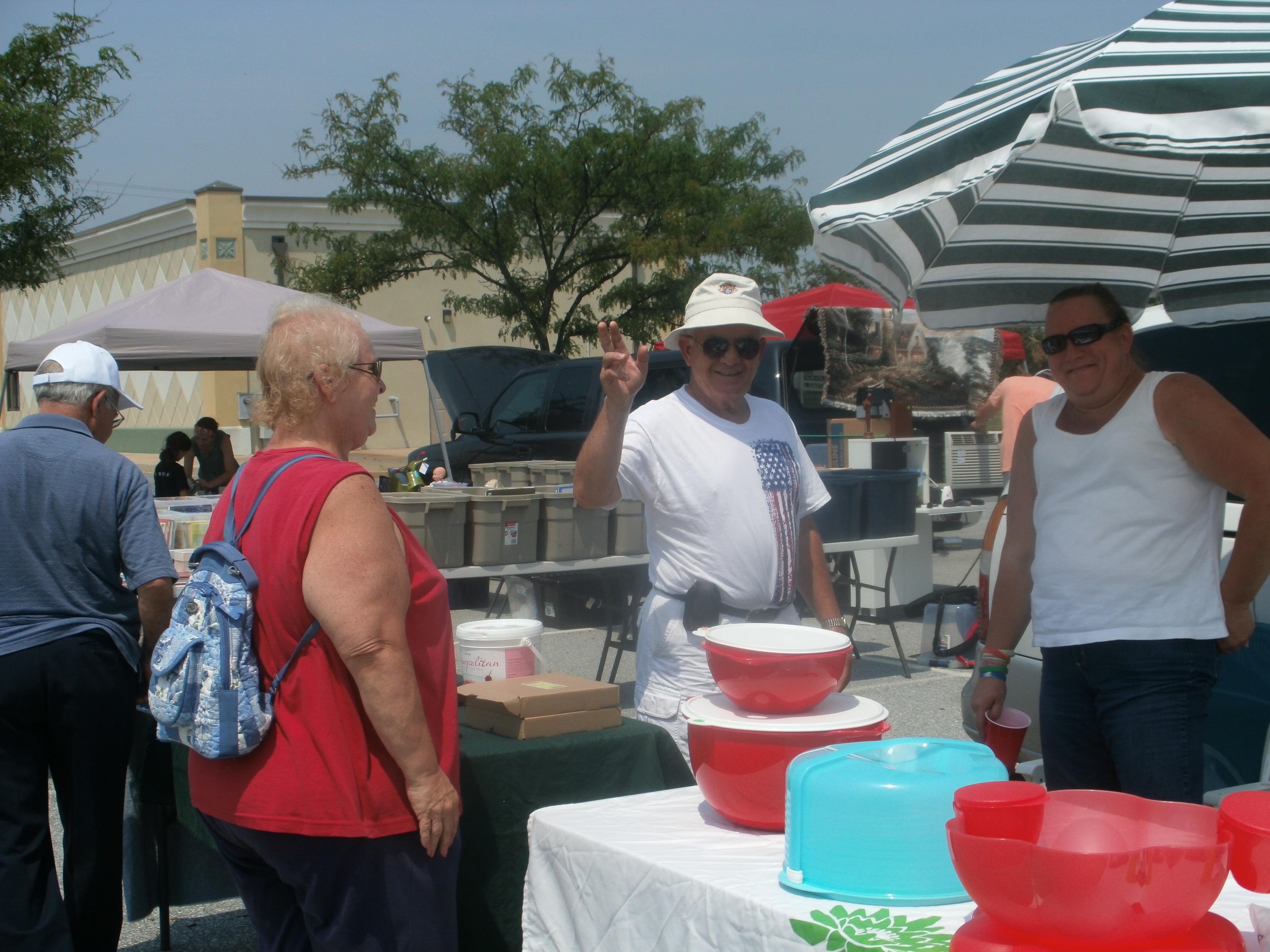 Lori Miller with customers.JPG