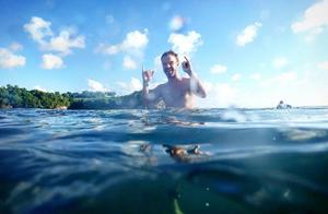 "alt=""Cute guy surfing the waves of Sri Lanka"""