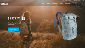 "alt=""woman standing in the fields of a mountain with a backpack"">"