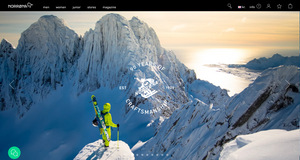 "alt=""man standing on norwegian mountain with skis looking at ski slope"""