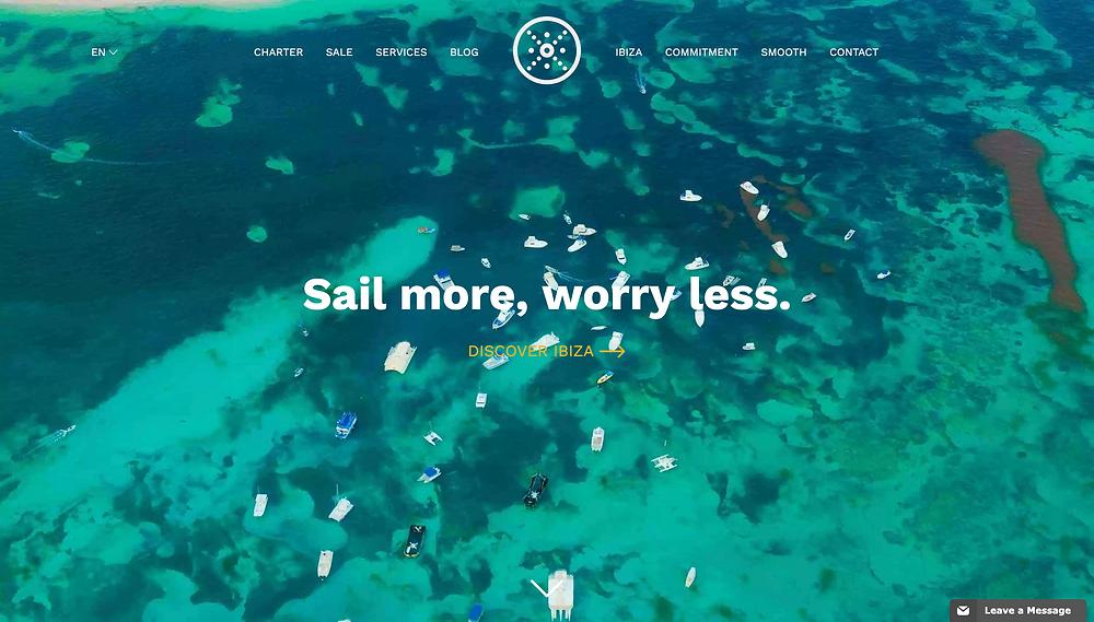 """alt=""""ocean in ibiza full of sailboats"""">"""