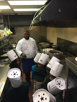 Chef Alfred teaching kids to cook