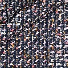 Tissu bouclé multicolore avec empiècements en lurex,