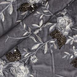 Tissu avec broderie florale et paillettes