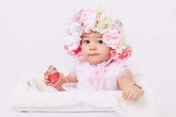 baby in floral bonnet