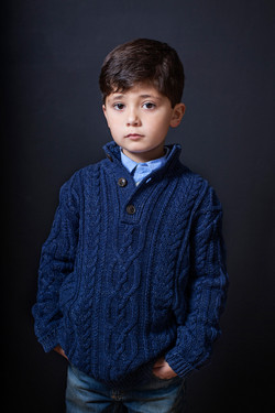 boy with blue sweater