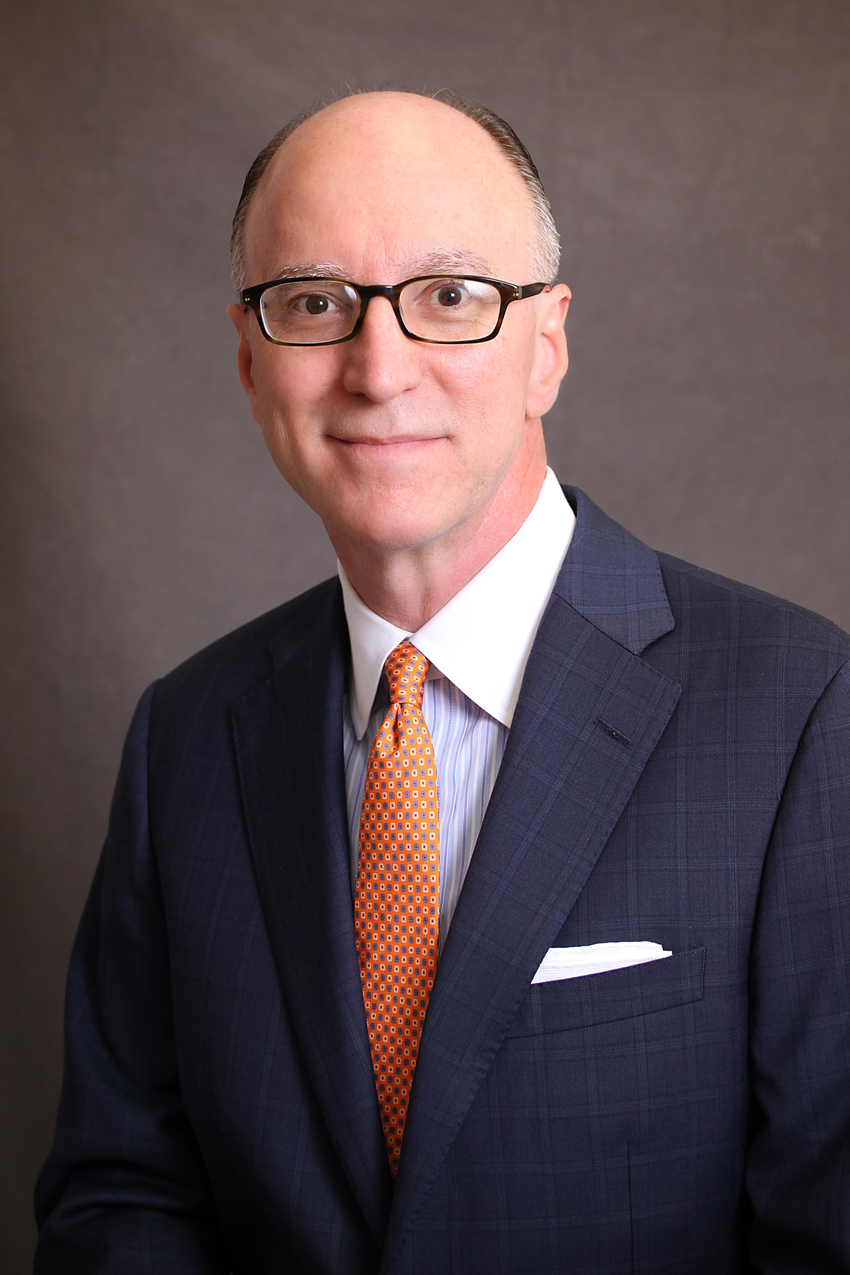 Jim in orange tie