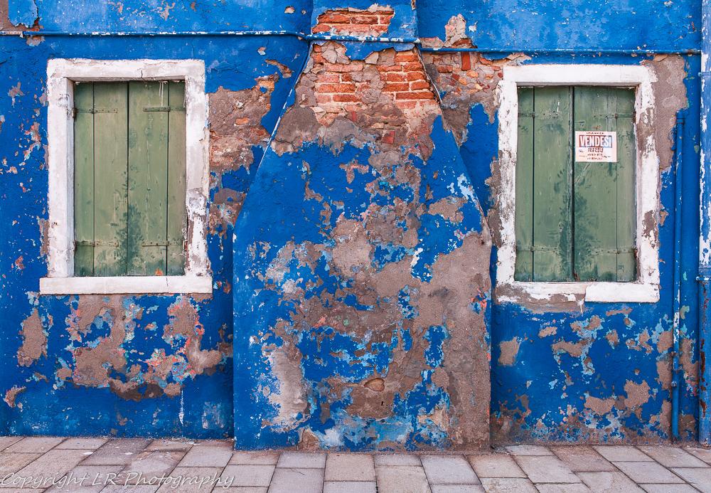 Crumbling Blue Facade