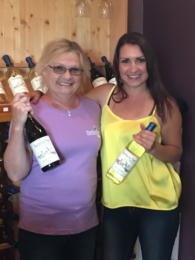 Choosing a favorite wine at Northern Sun Winery store.
