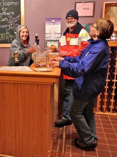 Wine tasting at Northern Sun Winery tasting room.