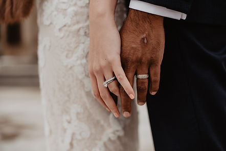 two-persons-wearing-silver-colored-rings