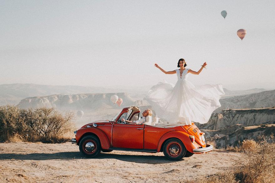 woman-standing-on-volkswagen-beetle-3342